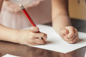 child-drawing-with-red-pencil-crayon_925x