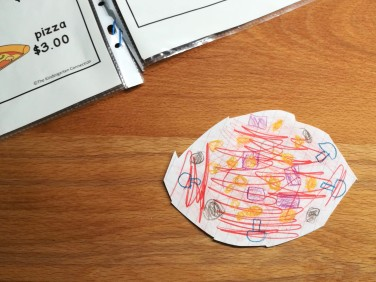 a pizza, drawn and cut out by a six year old student